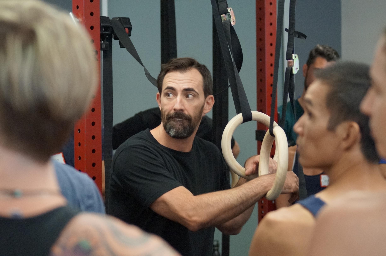 Ryan C. Hurst gymnastics rings at a seminar in USA