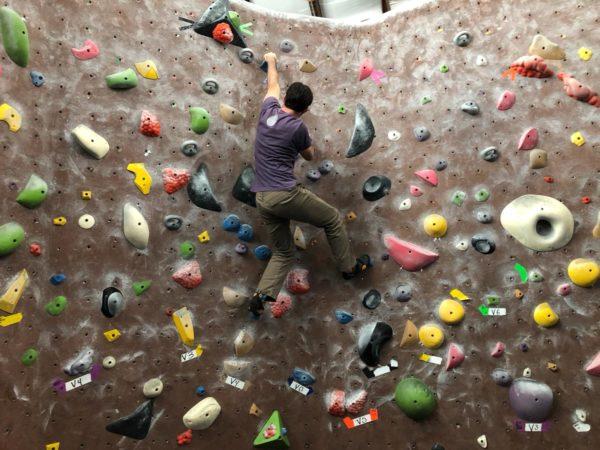 Climbing an indoor rock wall in California